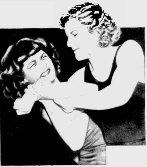 "In Training, And In The Ring, Clara Mortensen Is No Gentle Home Body.  She Wrestles To Win And No Hold Allowed By The Rules Is Barred.  That's Why Some Of Her Opponents Call Her A ""Tigress."""