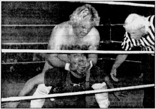 """""""Playboy"""" Buddy Rose applies a rear chinlock on an opponent in a match recently in Marion, Ohio."""