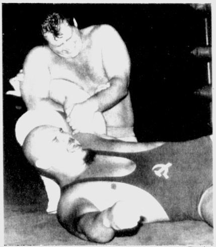 Krusher Khrushchev screams in Russian agony as Mark Fleming applies an arm lock.