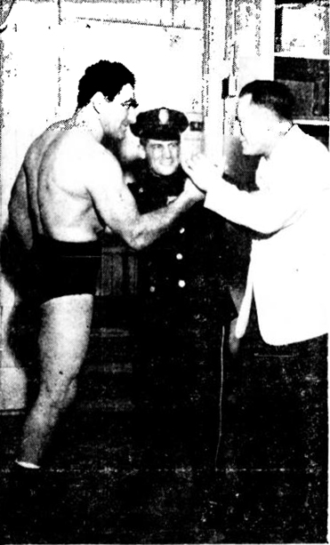 ON YOUR MARK... Just for kicks, of course.  Police Sgt. Edward Garrity, right, is just kidding as he makes to tackle the villain of the police VFW past annual wrestling show.  Peace-maker in center is Ptlmn William Kearns.