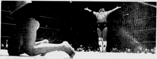 Virtue's Triumph His arms uplifted in victory, Dusty Rhodes has vanquished another baddie.