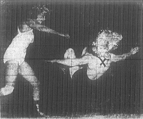 Lady wrestler Helen Hild throws Nell Stewart